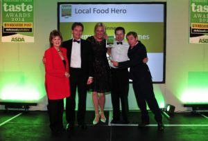 16 October 2014.......   Winners of the Best Local Food Hero Jeremy and Louise Holmes presented with their award by Judy Bell, Nigel Pullings from sponsors Local Enterprise Partnership and Nigel Barden Deliciouslyorkshire, Yorkshire Post and Asda Taste Awards 2014 at The Pavilions. HarrogateTJ100559aq
